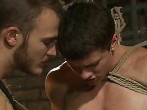 BDSM bondage gay boy is bound and whipped