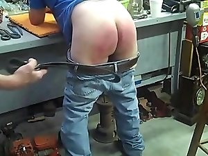 Son strapped by Dad out in the Garage!